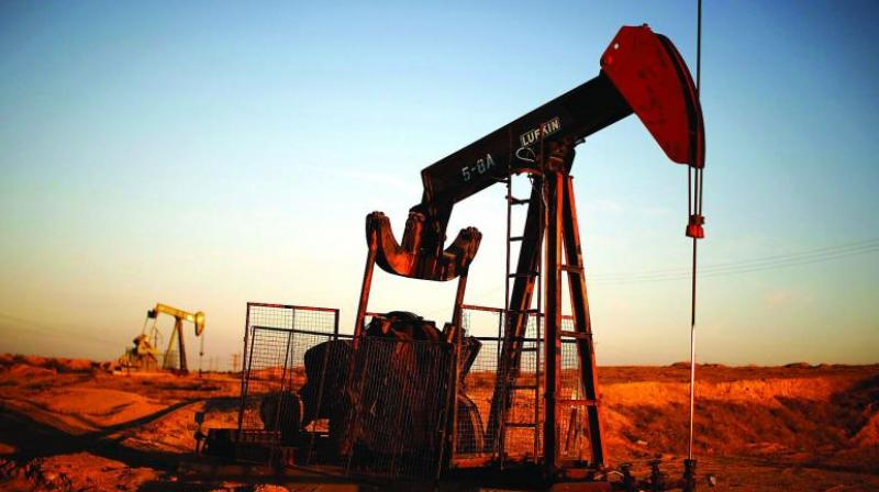 Oil prices dipped on Thursday after the United States recorded its biggest one-day spike in coronavirus cases. (AFP Photo)