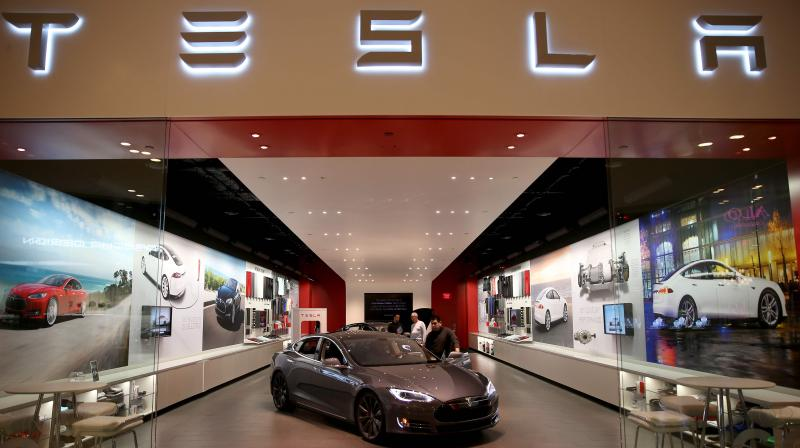 Tesla Inc on Thursday denied media reports and said it had not fired employees who chose to stay at home during the coronavirus pandemic. (AFP Photo)