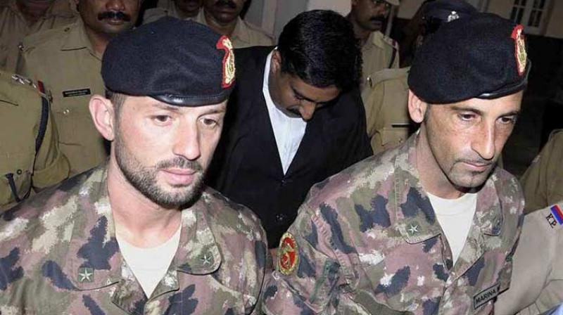 Photo of the two Italian marines, Sergeant Major Salvatore Girone (L) and Chief Master Sergeant Massimiliano Latorre (R), accused of killing two Indian fishermen in 2012. (AP Photo)
