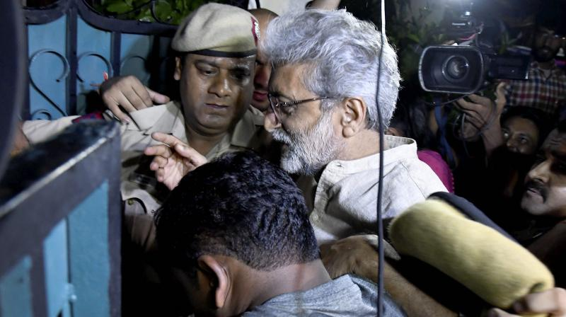 SC sets aside the Delhi High Court order asking the NIA to produce judicial records on transfer of civil rights activist Gautam Navlakha from Delhi to Mumbai in connection with the Bhima Koregaon case. (PTI Photo)