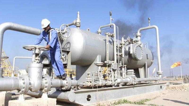 Oil prices cautiously rose in early trade on Tuesday with major producers sticking to supply cuts. (AFP Photo)