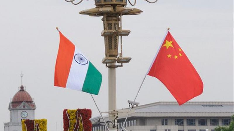 Indian government is reviewing around 50 investment proposals involving Chinese companies under a new screening policy. (AFP Photo)