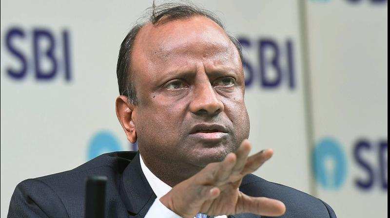 SBI chairperson Rajnish Kumar. State bank of India approved a further investment of upto 17.60 billion rupees in public offering of Yes Bank. (PTI Photo)