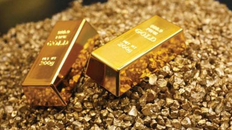 Gold prices edged higher on Monday, holding above the key $1,800-per-ounce level. (PTI Photo)