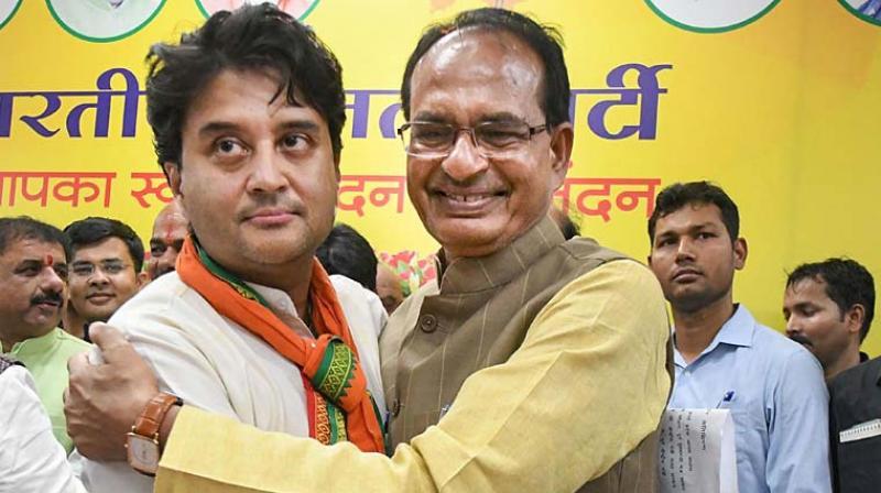 Shivraj Singh Chouhan (right) with Jyotiraditya Scindia. CM Shivraj on Monday allocated portfolios to the new ministers. (PTI Photo)