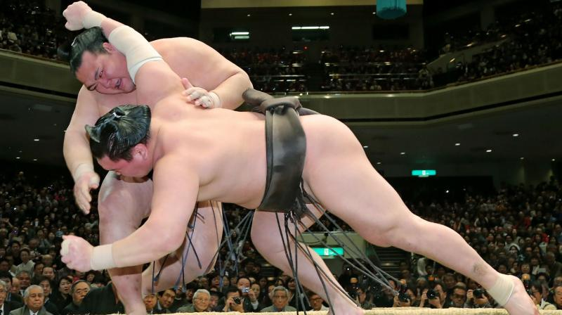 Sumo began a new tournament in front of a live audience Sunday. (AFP Photo)