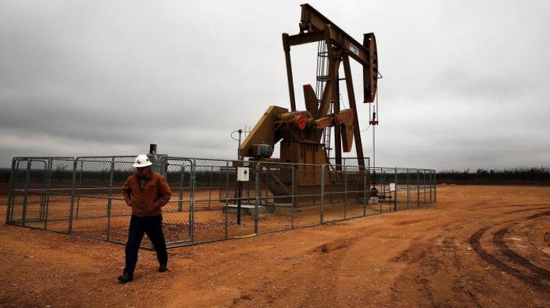 Oil prices were little changed on Tuesday, trapped in the narrow trading band of the past three weeks as investors gauged hopes for a recovery in oil demand. (AFP Photo)