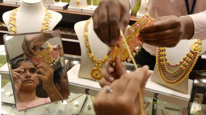 India gold prices hit all-time high, dampens retail demand. (AFP Photo)