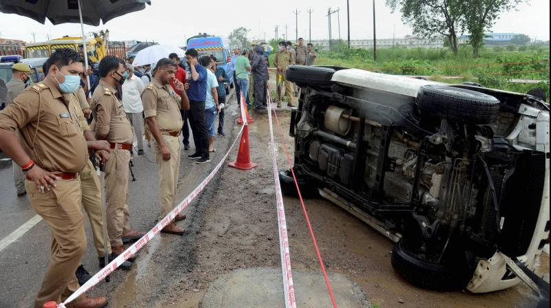Police inspect the encounter site where gangster Vikas Dubey was killed when he allegedly tried to escape from the spot following an accident, near Kanpur. (PTI Photo)