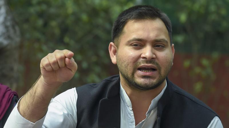 RJD leader Tejashwi Yadav and the party's national general secretary landed in Guwahati and held a series of meetings with top leaders of some regional parties. — PTI