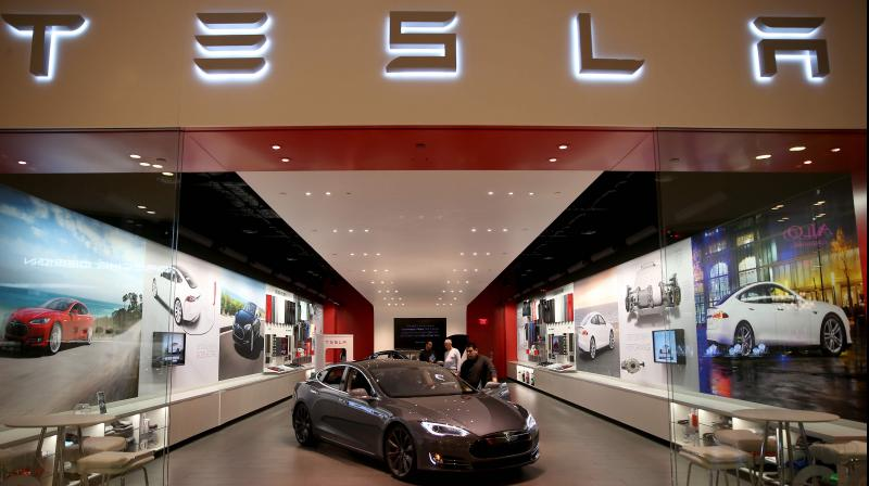 Tesla overcame a seven-week pandemic-related shutdown at its California assembly plant to post a surprising $104 million net profit for the second quarter. (AFP Photo)