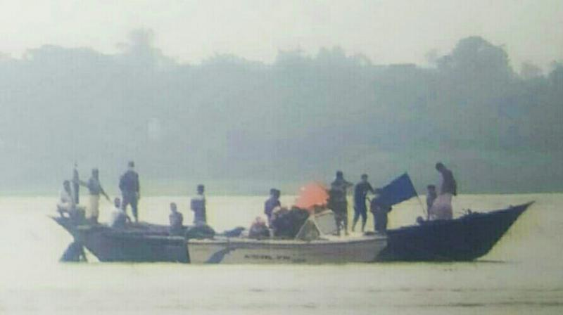 Border Security Force (BSF) handed over four Bangladeshi fishermen, caught in Murshidabad of West Bengal. (DC Photo)