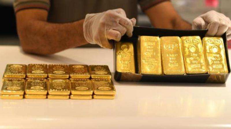 Gold hit an all-time high on Monday as tit-for-tat consulate closures in China and the United States rattled investors. (AFP Photo)