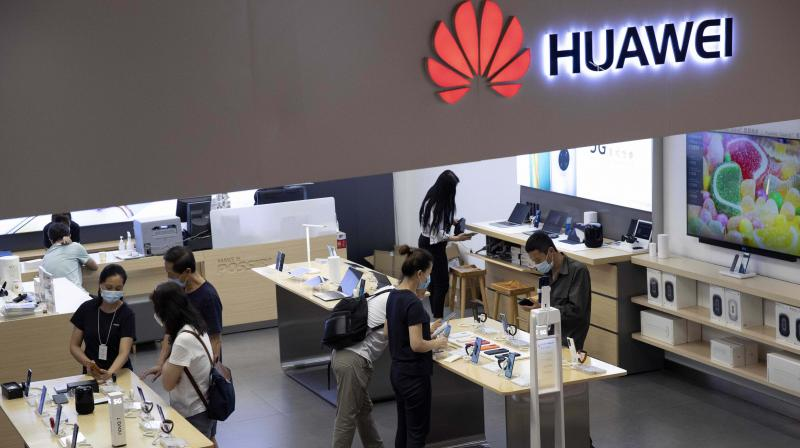 Huawei cuts India revenue target by up to 50%, laying off staff. (AP Photo)
