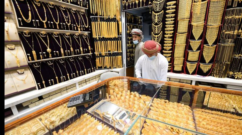 Gold hits record, gets more precious as dollar loses value. (AFP Photo)