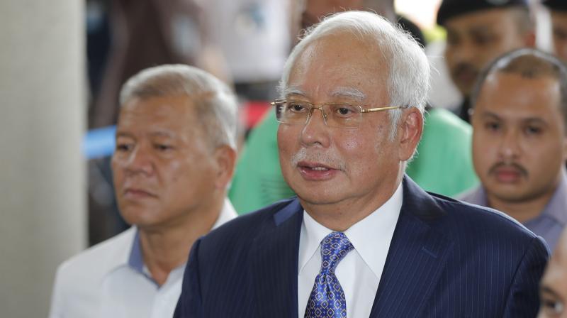 Former Malaysian Prime Minister Najib Razak, center, walks into a courtroom at Kuala Lumpur High Court in Kuala Lumpur, Malaysia. (AFP Photo)
