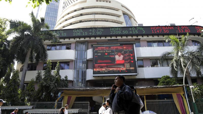 Sensex surged over 558 points and the NSE Nifty topped the 11,300-mark on Tuesday. (AP Photo)