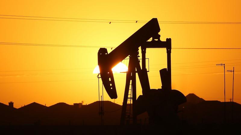 Oil rises after surprise drop in U.S. inventories offsets demand concerns. (AFP Photo)