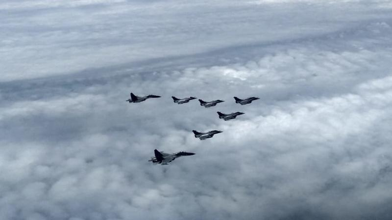 The five Rafales fly in formation into Indian air space after taking of from Dubai. (PTI Photo)