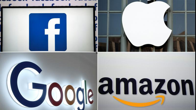 Staggering economic fallout caused by the coronavirus pandemic was reflected in reports released Thursday from Amazon, Facebook, Apple and Google's corporate parent, Alphabet. (AFP Photo)