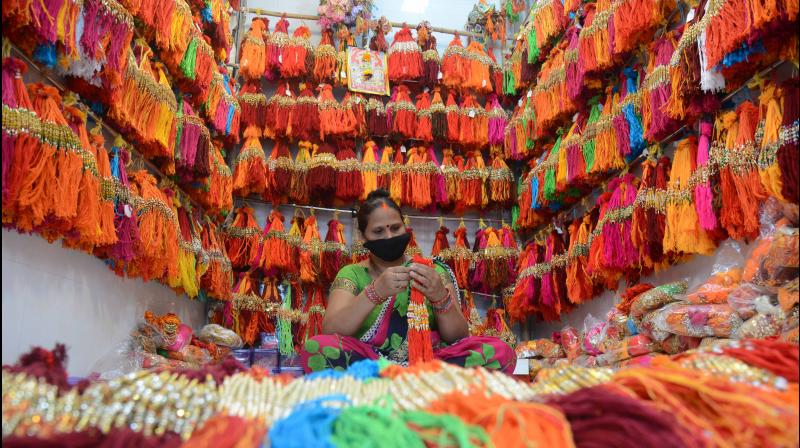 A woman waits for buyers in her wholesale rakhi shop in Dharavi in Mumbai. As Dharavi is a coronavirus containment zone, people are rarely coming out to shop. (DC photo: Rajesh Jadhav)