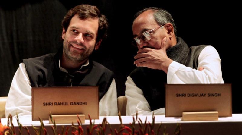 """Digvijay Singh on Sunday bringing in Rahul Gandhi directly, saying the former Congress chief should be more active inside Parliament and undertake """"yatras"""" across India. (PTI Photo)"""