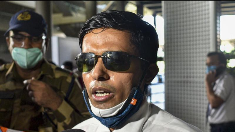IPS Officer Vinay Tiwari speaks to media personnel after arriving in the city for investigation in the ongoing death by suicide case of Bollywood actor Sushant Singh, in Mumbai on Sunday. (PTI Photo)