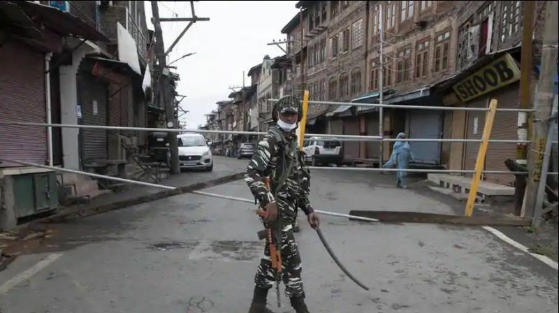 An Indian paramilitary soldier stands guard by a closed road, as Kashmiris marked Eid during lockdown to curb the spread of coronavirus in in Srinagar. (AP Photo)