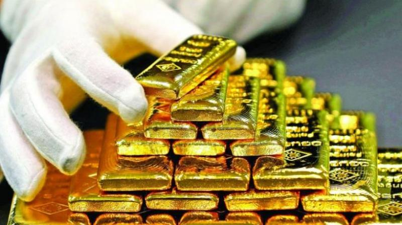 Gold rises by Rs 97, silver almost flat . (AFP Photo)