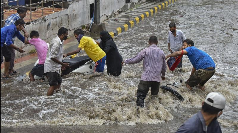 Heavy rains lashed parts of Mumbai and neighbouring Thane and Palghar districts of Maharashtra on Wednesday morning. (PTI Photo)