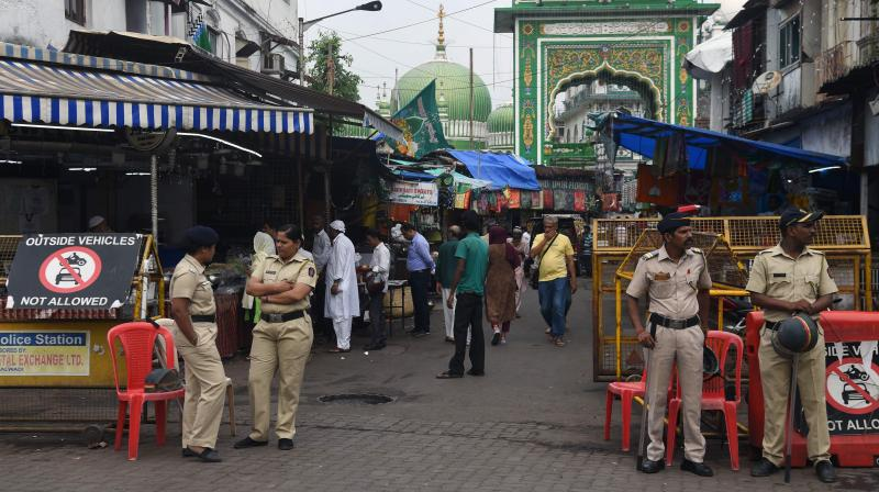 Police stand next to roadblock on the street leading to a mosque in a Muslim majority neighbourhood in Mumbai. Maharashtra government has issued preventive orders in some parts of the state warning action against holding victory rallies and celebrations. (PTI Photo)