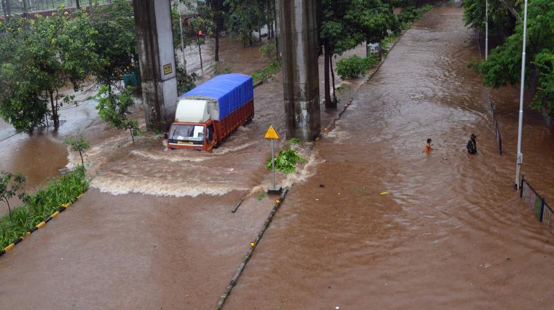 Heavy rain lashed Mumbai city, seen in the picture low lying area of Mumbai like wadala under rain flooded water on Tuesday. (DC Photo- Rajesh Jadhav)