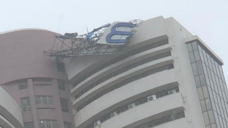 Signage atop BSE building gets damaged in Mumbai rains. (Photo-Twitter/@ashishchauhan)
