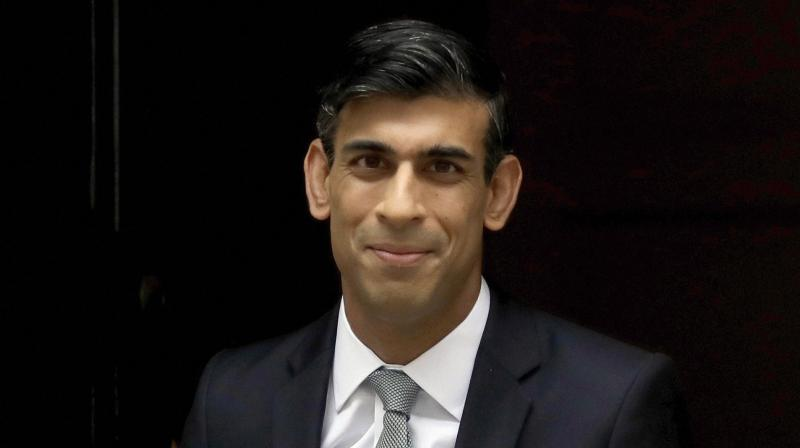 Britain's Finance minister Rishi Sunak said that hundreds of thousands of people have already lost their jobs, and sadly in the coming months many more will. (AP Photo)