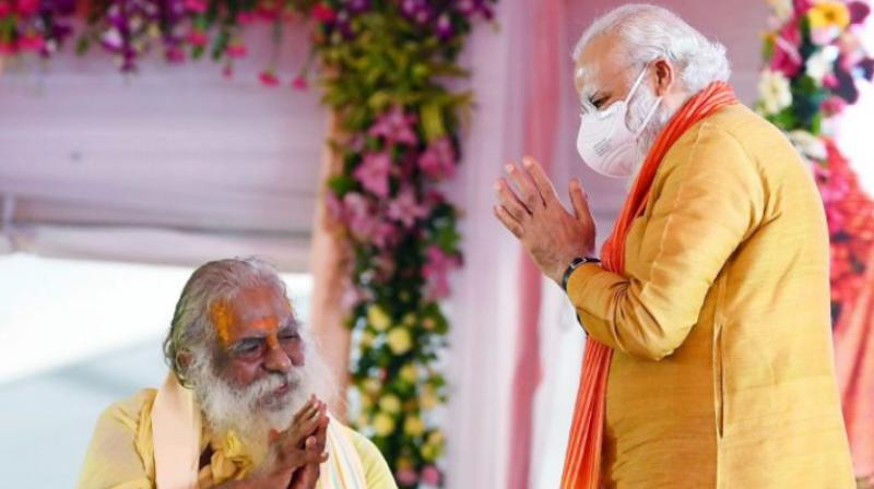 Prime Minister Narendra Modi greets Ram temple trust Mahant Nritya Gopal Das during the bhoomi pujan event in Ayodhya held on August 5, 2020. (PTI Photo)