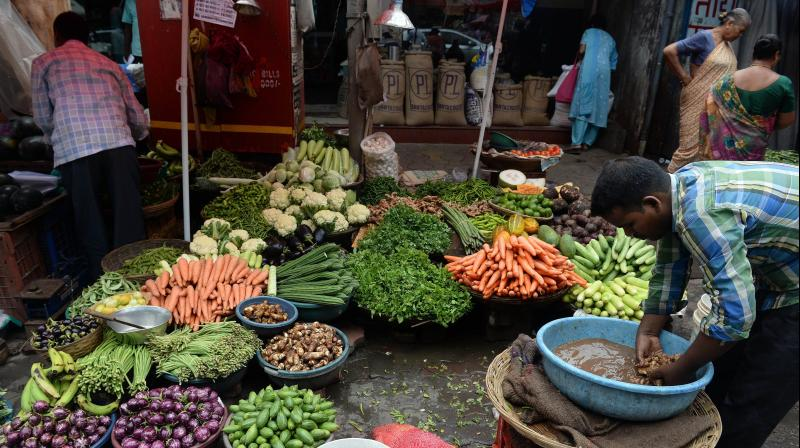 India's July retail inflation dims chances of rate cut. (AFP Photo)