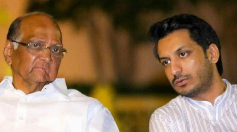 A file photo of NCP chief Sharad Pawar (left) with his grand nephew Parth Pawar. (Photo- Parth Pawar/Facebook)