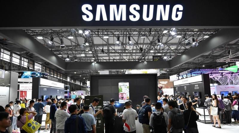 Samsung plans producing Rs 3.7 lakh cr worth mobile phones in India over 5 yrs. (PTI Photo)