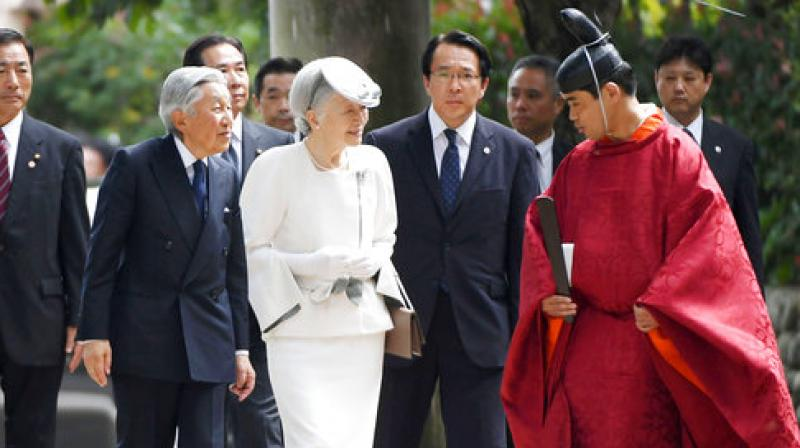 Japan's Emperor Akihito, second from left, and Empress Michiko, listen to a priest, right, as they visit Koma Shrine in Hidaka, northwest of Tokyo, Wednesday, Sept. 20, 2017. (Photo: AP)