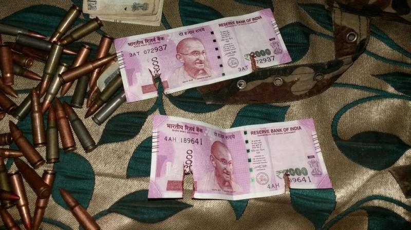 New Rs 2000 notes recovered from terrorists gunned down by Army in J&K's Bandipora. (Photo: Twitter/ANI)