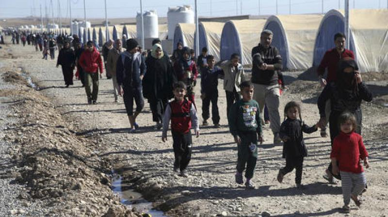 The UN had initially predicted that 200,000 civilians could be forced from their homes in the first few weeks of the offensive, Iraq's biggest military operation in years. (Photo: AP)