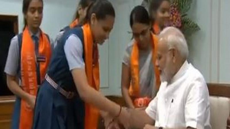 Shaikh, a Pakistani national who came to India after marriage, had earlier said that she had been tying rakhi on Modi's wrist for last 25 years. (Photo: ANI)