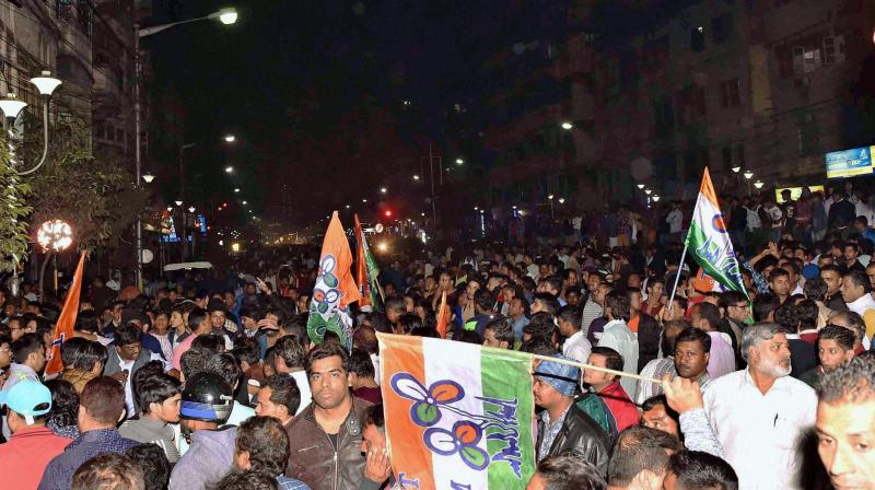 Trinamool Congress activists shouting slogans in front of BJP State party office in Kolkata on Tuesday over the arrest of Sudip Bandyopadhyay. (Photo: PTI)