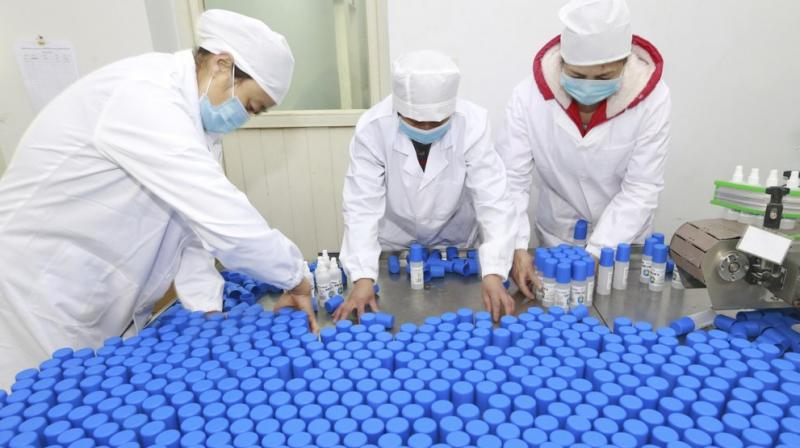 Workers pack bottles of alcohol disinfectant in a factory in Suining in southwest China's Sichuan province. AP photo