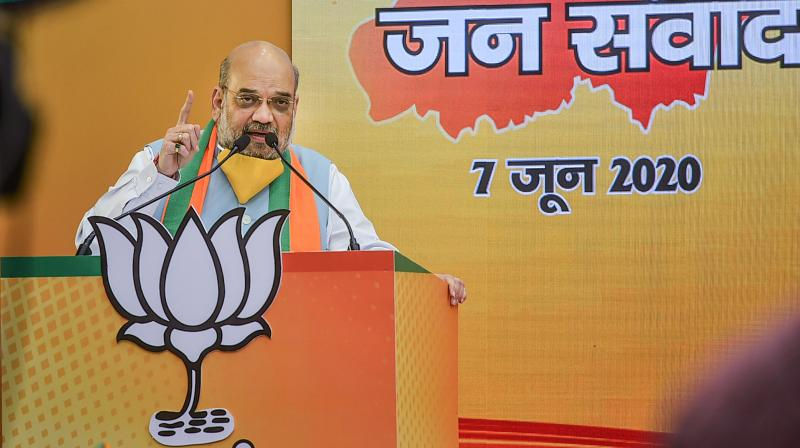 Amit Shah addresses Bihar Jan Samvad rally via video conferncing at the party headqaurters in New Delhi. PTI photo
