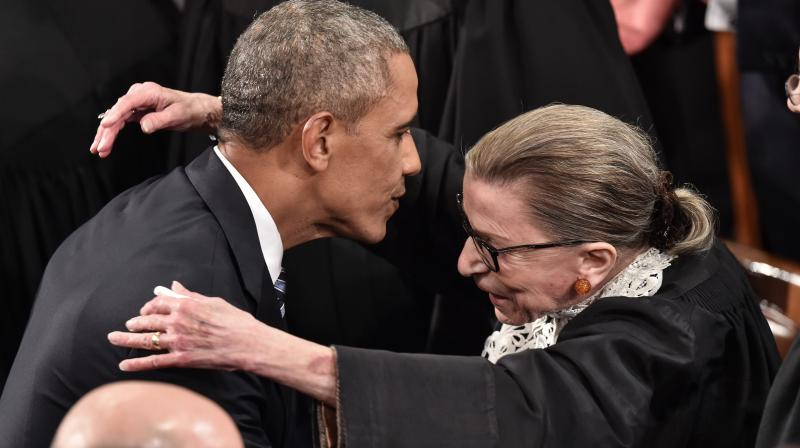 US President Barack Obama is greeted by Supreme Court Justice Ruth Bader Ginsburg as he arrives to deliver the State of the Union address at the US Capitol in Washington, DC.(AFP File)