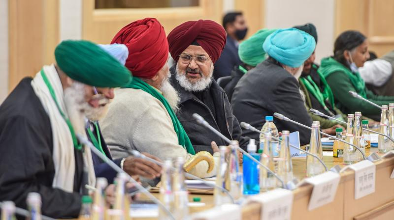 Farmers leaders during a meeting with Union Minister for Agriculture and Farmers Welfare Narendra Singh Tomar (unseen) and Union Minister for Commerce and Industry Piyush Goyal (unseen) over the new farm laws, at Vigyan Bhawan in New Delhi, Wednesday, December. 30, 2020. (PTI/Shahbaz Khan)