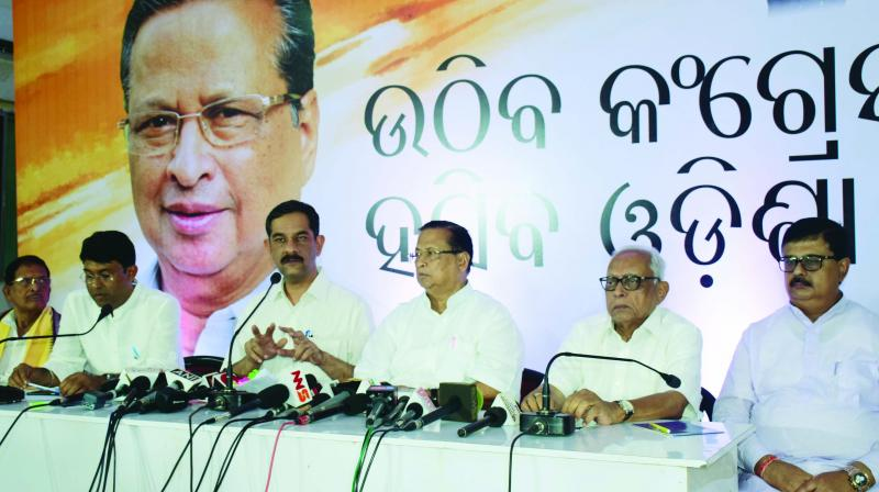 AICC general secretary Jitendra Singh (third from left) along with top Odisha Congress leaders address media in Bhubaneswar.