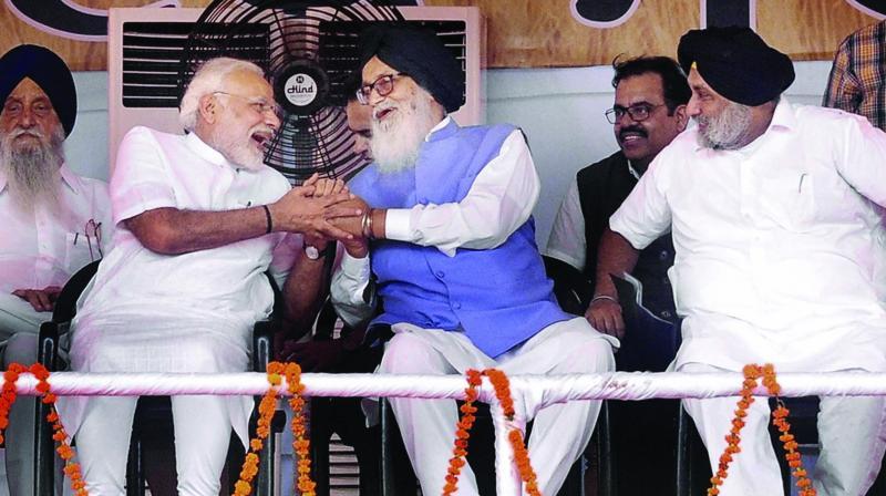 Prime Minister Narendra Modi with former Punjab chief minister Parkash Singh Badal and SAD president Sukhbir Singh Badal during the Kisan Kalyan Rally in Malout, Punjab. (Photo: PTI)