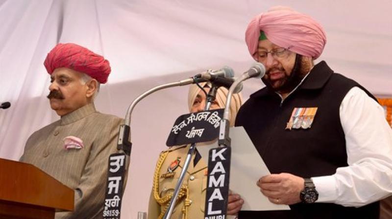 Punjab Chief Minister Amarinder Singh taking oath. (Photo: PTI)
